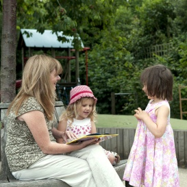 sharing books outdoors